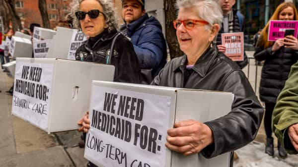 Protesters holding boxes with a print on it. Outside the NYC Federal Building which contains Medicaid offices, hundreds of New Yorkers who rely on Medicaid.