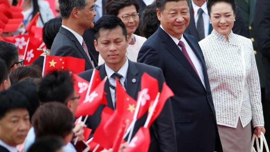 Chinese President Xi Jinping and his wife Peng Liyuan arrive in Hong Kong, China, ahead of celebrations marking the city's handover from British to Chinese rule on June 29, 2017.