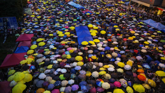 Umbrellas are opened as tens of thousands come to the main protest site one month after the Hong Kong police used tear gas to disperse protesters October 28, 2014 in Hong Kong, Hong Kong.