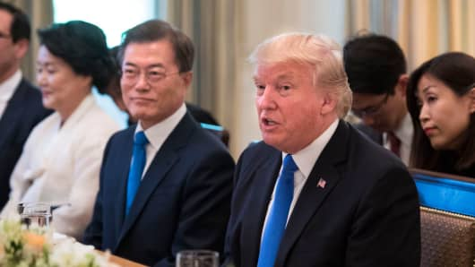 US President Donald Trump and South Korean President Moon Jae-in address the media prior to dinner in the State Dinning Room at the White House on June 29, 2017 in Washington, D.C.