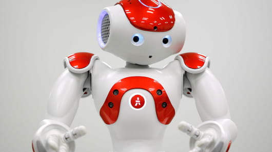 A NAO humanoid robot, developed by Softbank Corp. subsidiary Aldebaran Robotics SA, performs during a demonstration in Tokyo, Japan, on Wednesday, Jan. 28, 2015. Mitsubishi UFJ Financial Group Inc. unveiled the 58-centimeter (23-inch) humanoid to improve services for customers in Japan and become the first bank in the world to use robots at branches, it said.