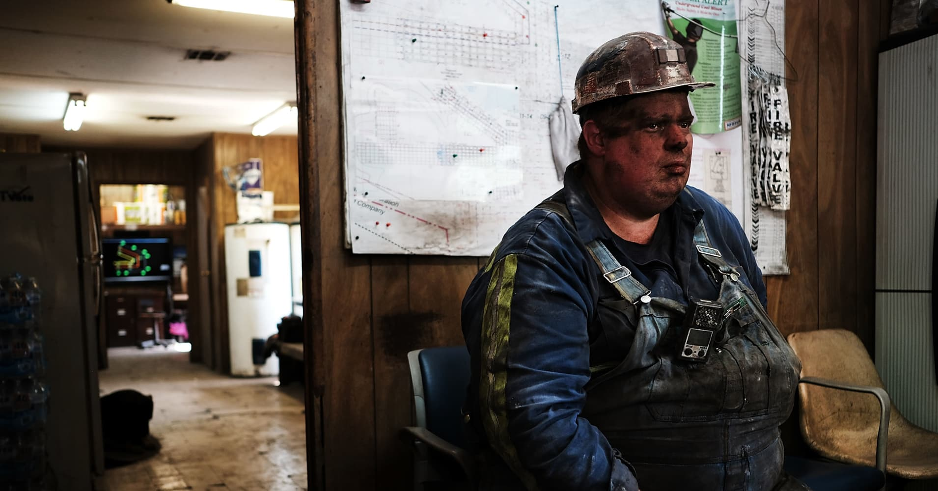 "A coal miner takes a break after his shift at a small mine outside the city of Welch, West Virginia, on May 19, 2017. Despite Trump's repeated promises to ""put the miners back to work,"" and promises from Gov. Justice to do the same, West Virginia University researchers predict coal-mining employment will resume its decline."