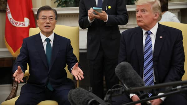 President Donald Trump (R) meets with South Korean President Moon Jae-in in the White House Oval Office in Washington, U.S., June 30, 2017.