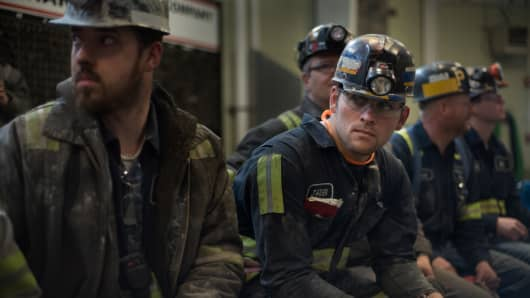 Coal miners at the Harvey Mine in Sycamore, Pennsylvania, wait for the arrival of the U.S. Environmental Protection Agency administrator.