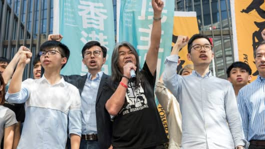 (From L to R) Student protest leader Joshua Wong, Hong Kong pro-democracy party League of Social Democrats (LSD) chairman Avery Ng, pro-democracy lawmaker Leung Kwok-hung and pro-democracy lawmaker Nathan Law hold a protest against their recent arrests in Hong Kong on June 30, 2017.