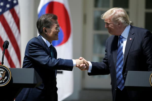 President Donald Trump (R) greets South Korean President Moon Jae-in prior to delivering a joint statement from the Rose Garden of the White House in Washington, U.S., June 30, 2017.