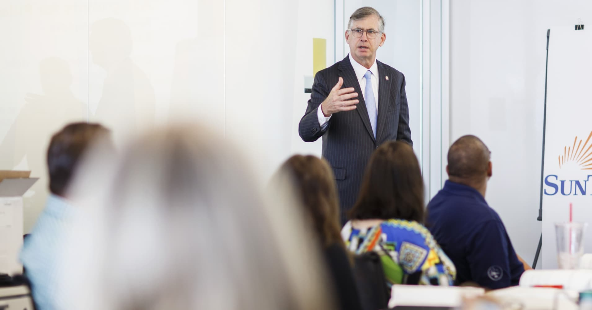 Bill Rogers, chief executive of SunTrust Banks, speaks to employees learning to be trainers for an employee financial wellness program, in Atlanta, June 23, 2017.