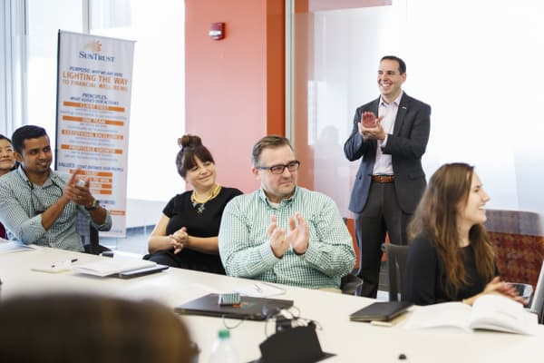 Brian Nelson Ford, who develops SunTrust Banks' financial wellness program, with employees learning to be trainers for the program, in Atlanta, June 23, 2017.