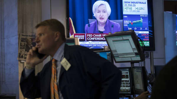 Traders work as a television monitor displays Federal Reserve Chair Janet Yellen announcing the Fed's decision to raise interest rates on the floor of the New York Stock Exchange (NYSE) June 14, 2017 in New York City.