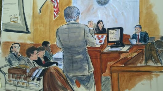 Courtroom sketch of Fred Hassan on stand being cross examined by defense attorney Ben Brafman.  Far left is Martin Shkreli seated.