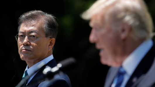 President Donald Trump (R) and South Korean President Moon Jae-in deliver a joint statement from the Rose Garden of the White House in Washington, U.S., June 30, 2017.
