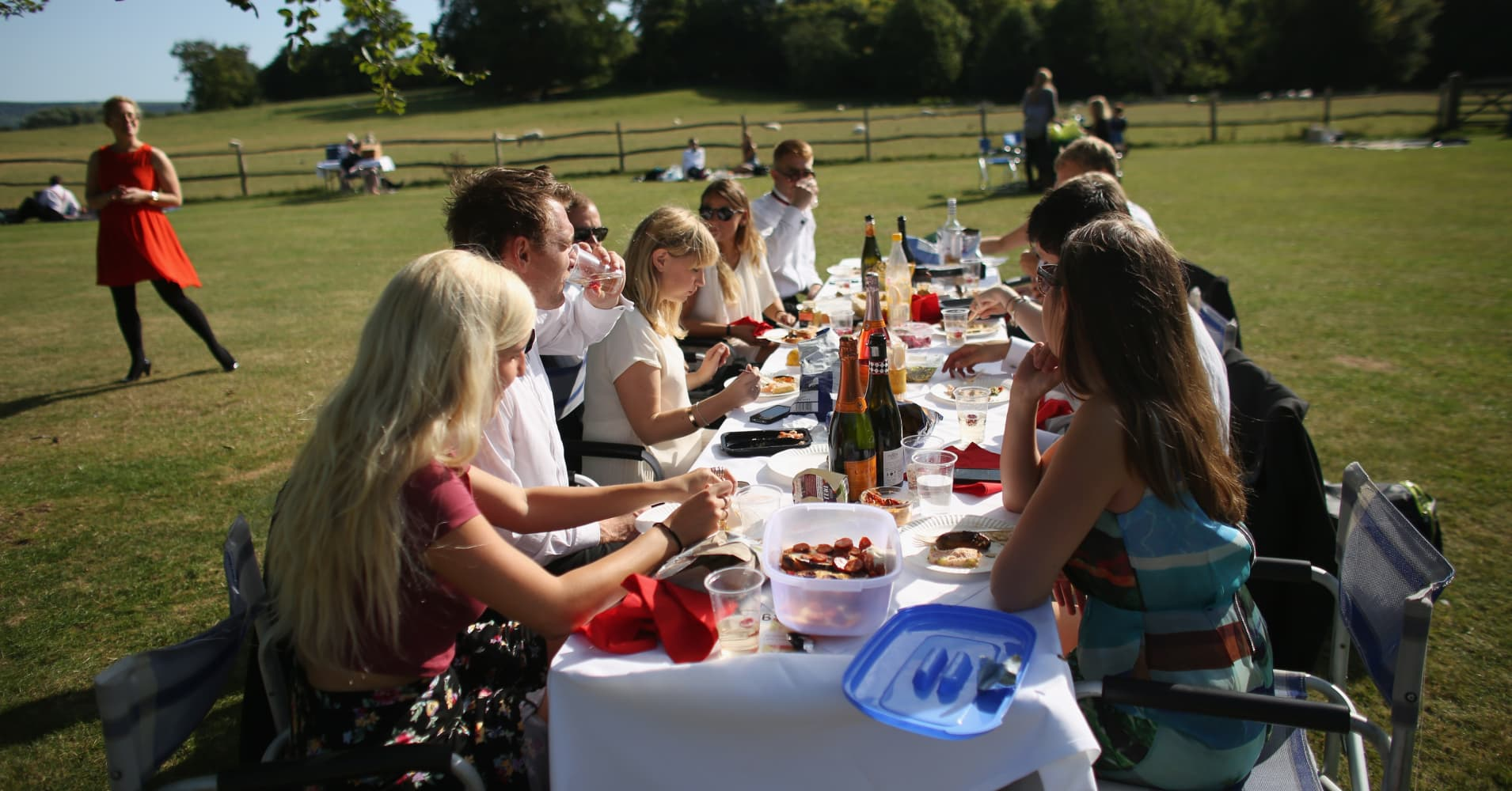 Audience members picnic before a production of the Benjamin Britten opera 'Billy Budd' on August 22, 21013 in Lewes, England.