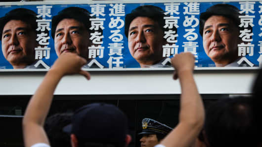 Posters of Japanese Prime Minister Shinzo Abe seen during the election campaign for the Tokyo Metropolitan Assembly on July 1, 2017 in Tokyo, Japan.