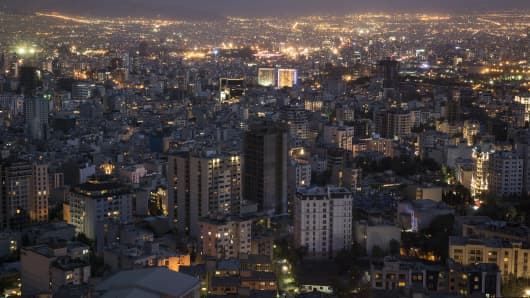 Residential and commercial properties sit illuminated on the city skyline in Tehran, Iran, on Tuesday, Aug. 25, 2015.