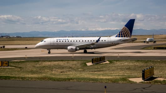 A United Airlines jet moves off the runway and to the B terminal at Denver International Airport.