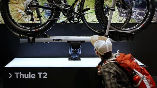 Here, a shopper browses a Thule bicycle rack. Thule is one of nearly 4,000 manufacturers in Connecticut, representing one of the bright spots in the economy. Connecticut currently employs almost 160,000 people in manufacturing.