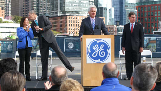 Massachusetts Governor Charlie Baker, second from left, and GE chairman and former CEO Jeff Immelt, at podium, break ground for new GE headquarters. May 8, 2017
