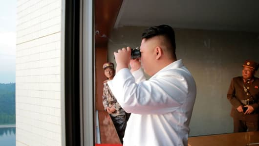 This undated photo released by North Korea's official Korean Central News Agency (KCNA) on May 30, 2017 shows North Korean leader Kim Jong-Un inspecting a test-fire of a ballistic missile at an undisclosed location in North Korea.