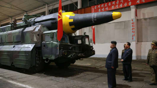 This picture taken on May 14, 2017 and released from North Korea's official Korean Central News Agency (KCNA) shows North Korean leader Kim Jong-Un (3rd R) inspecting a ballistic rocket at an undisclosed location.