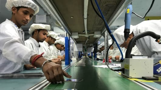 Workers at an Intex factory in India.