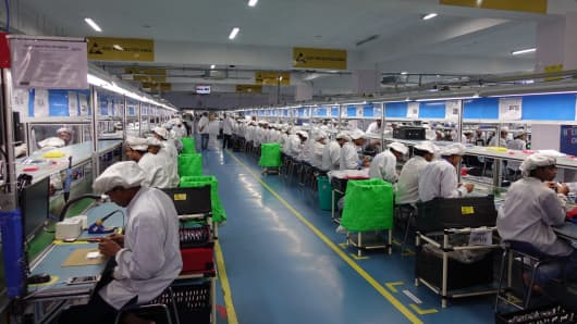 Employees at work in an Intex factory in India.