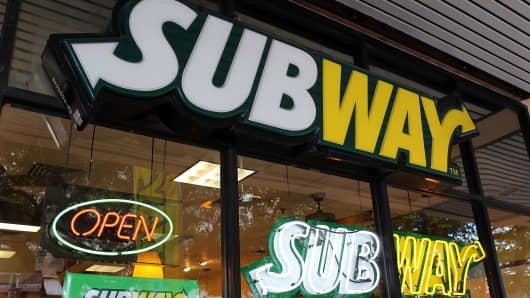 A Subway restaurant is seen as the company announced a settlement over a class-action lawsuit that alleged that Subway engaged in deceptive marketing for its 6-inch and 12-inch sandwiches and served customers less food than they were paying for on October 21, 2015 in Miami, Florida.