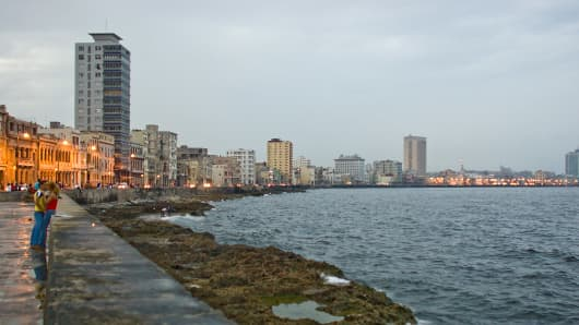 A love couple is seen on the seven kilometre sea wall 'Malecon' in Havana Bay