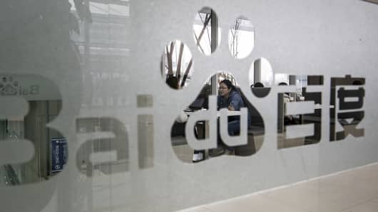 Signage for Baidu is displayed on a window at the Baidu Technology Park in Beijing, China, on Friday, Nov. 25, 2016.