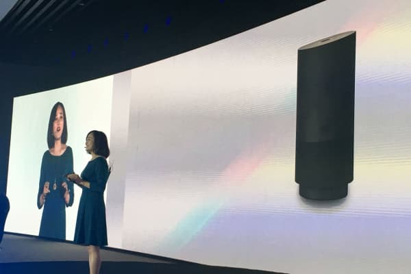 A member of staff from Alibaba Group introduces the company's newly released cut-price voice assistant speaker Tmall Genie during a press conference in Beijing, China, July 5, 2017.