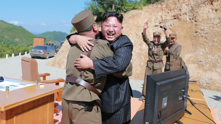 North Korean leader Kim Jong Un reacts with scientists and technicians of the DPRK Academy of Defence Science after the test-launch of the intercontinental ballistic missile Hwasong-14 in this undated photo released by North Korea's Korean Central News Agency (KCNA) in Pyongyang July, 5, 2017.