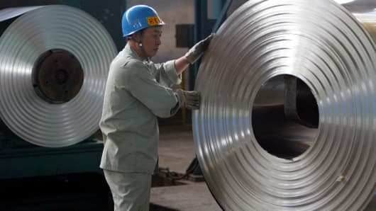 A worker at a cold-rolling mill on the outskirts of Wuhan, China.
