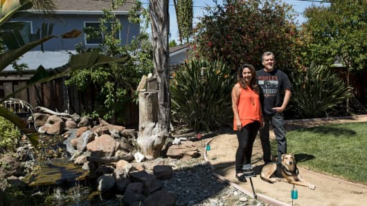 "Sheri and Ron Nielsen in the backyard of their home in the Birdland neighborhood of Sunnyvale, Calif., an area just across the street from Apple's new ""spaceship"" headquarters, May 18, 2017."