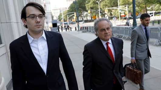 Martin Shkreli, former chief executive officer of Turing Pharmaceuticals AG, left, arrives at federal court with his attorney Benjamin Brafman in the Brooklyn borough of New York, U.S., on Wednesday, July 5, 2017.