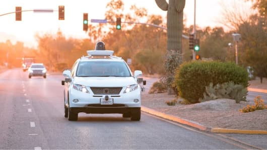 A Google Waymo self-driving Lexus on the road in Arizona