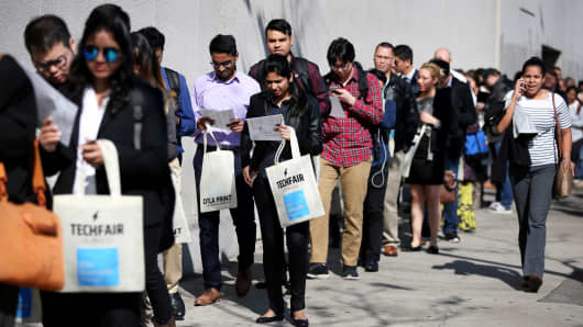 People wait in line to attend TechFair LA, a technology job fair in Los Angeles.