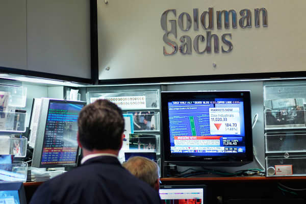 Monetary experts sit within the Goldman Sachs sales put on the flooring of the Serene York Stock Replace.