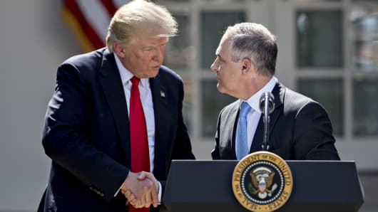 Scott Pruitt, administrator of the Environmental Protection Agency (EPA), right, shakes hands with President Donald Trump during an announcement in the Rose Garden of the White House on June 1, 2017.