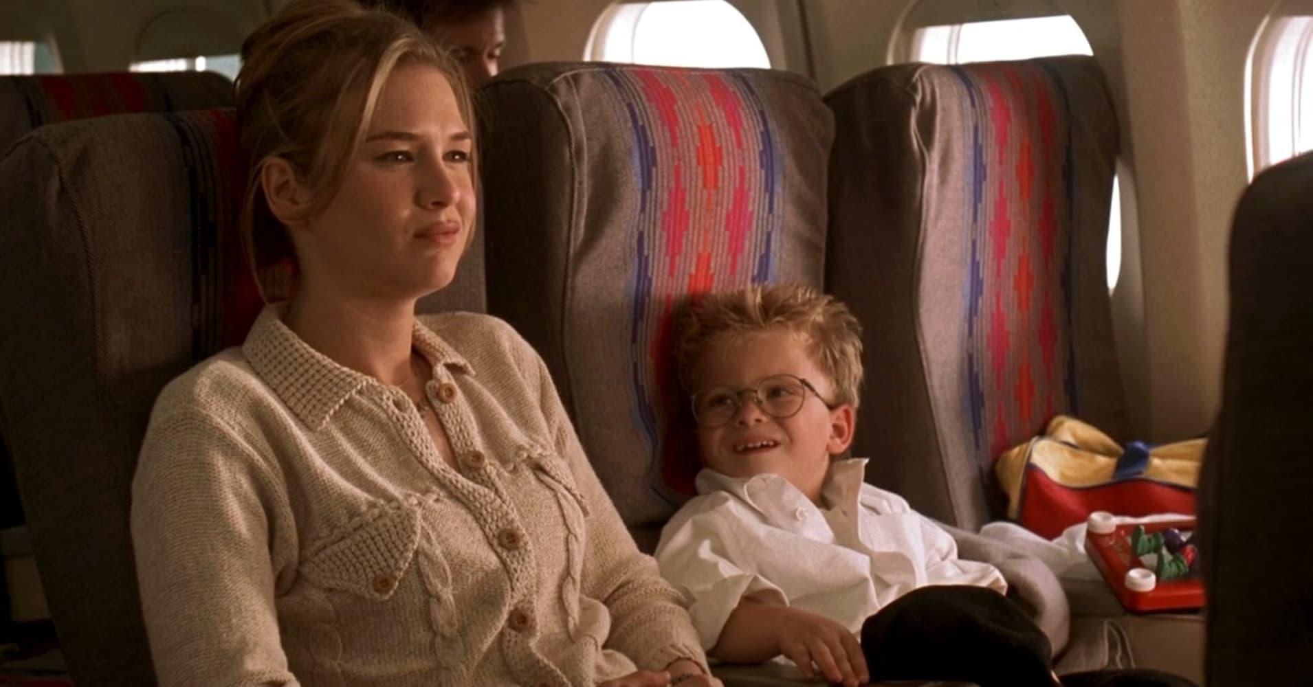 "Renee Zellweger flying coach in the 1996 film ""Jerry Maguire."""