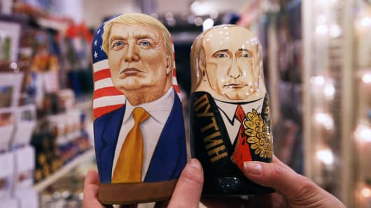 Russian dolls in the likeness of President Donald Trump (L) and Russia's president Vladimir Putin in a souvenir shop.