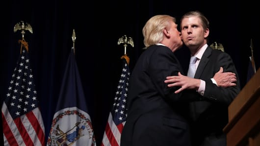 Then presidential candidate Donald Trump with his son Eric Trump during a campaign event at Briar Woods High School August 2, 2016 in Ashburn, Virginia.