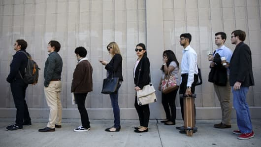 Job seekers wait in line during the TechFair LA job fair in Los Angeles, California, U.S., on Thursday, Jan. 26, 2017.