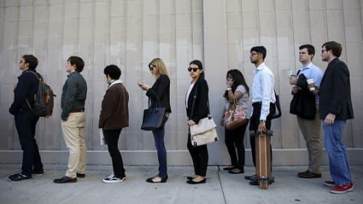 Job seekers wait in line during the TechFair LA job fair in Los Angeles.