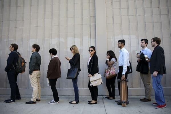 Job seekers wait in line during the TechFair LA job fair in Los Angeles, California, U.S., on Thursday, Jan. 26, 2017.