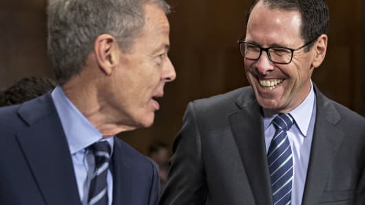 Randall Stephenson, chairman and chief executive officer of AT&T Inc., right, speaks with Jeffrey 'Jeff' Bewkes, chairman and chief executive officer of Time Warner Inc.
