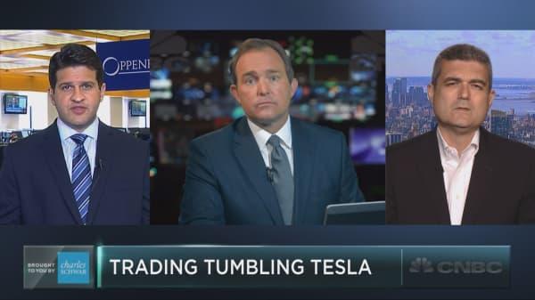 Trading tumbling Tesla shares