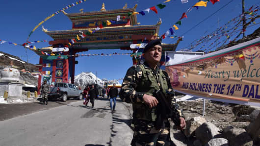 An Indian security personnel stands guard ahead of the arrival of the Dalai Lama near the Chinese border in India's north-eastern state of Arunachal Pradesh on April 7, 2017.