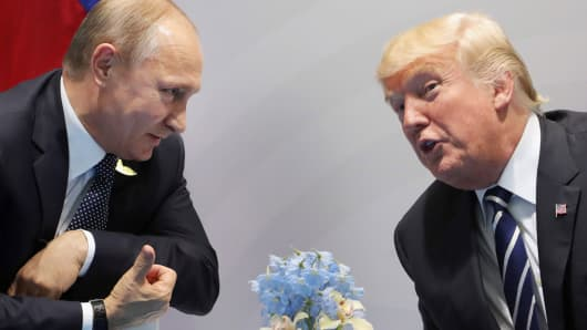 US President Donald Trump (R) and Russia's President Vladimir Putin speaks during their meeting on the sidelines of the G20 Summit in Hamburg, Germany, on July 7, 2017
