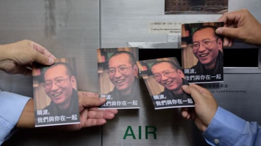Protestors prepare to post postcards written to terminally-ill Chinese Nobel laureate Liu Xiaobo on July 5, 2017