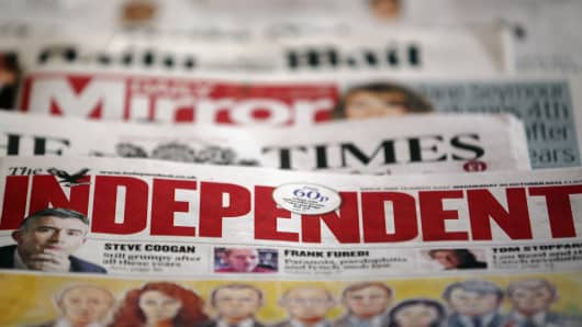 In this photo illustration a selection of UK national newspapers are displayed together on October 30, 2013 in London, England.