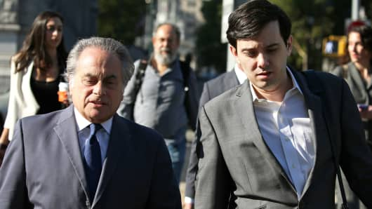 Martin Shkreli, former chief executive officer of Turing Pharmaceuticals AG, right, arrives at federal court with his attorney Benjamin Brafman in the Brooklyn borough of New York, on Monday, July 10, 2017.